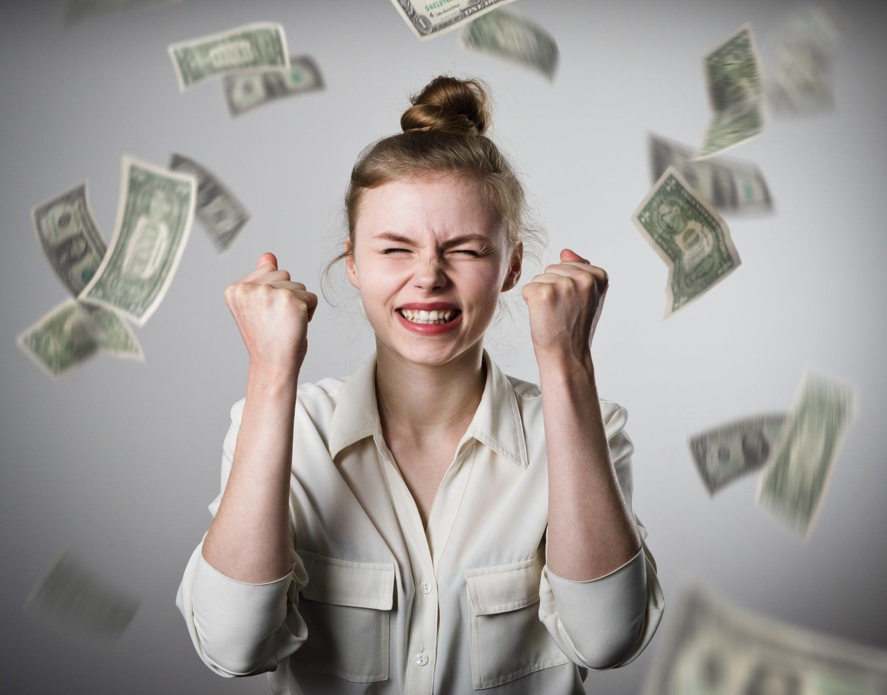 money-raining-on-woman-celebrating